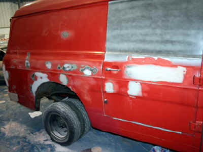 old_ford_transit_red_full-Respray_restoration_filler_driver_side.jpg (72588 bytes)